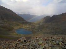 Rainbow in the Caucasus. Valley in Caucasus mountains, Karachay-Cherkessia, Russia Stock Photo