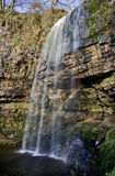 Rainbow caught in Sgwd Henrhyd; henrhyd Waterfall Royalty Free Stock Photo