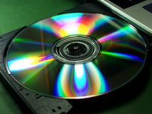 Rainbow cd rom. Insert rainbow cd into cd player royalty free stock photos