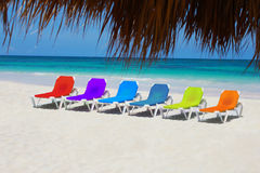 Rainbow chairs on Love Beach, The Bahamas. Postcard from the Caribbean - Rainbow chairs on a tropical Beach Stock Photos