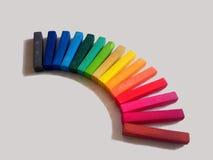 Rainbow chalk. Multicolour chalk isolated on the light background Stock Photography