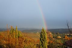 Rainbow in the characteristic landscape of Tuscany. The hills of Chianti south of royalty free stock images