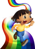 A rainbow with a child playing Royalty Free Stock Photo