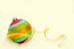 Rainbow Christmas ball with ribbon with free copy space backgrou Stock Photo