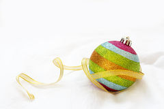 Rainbow Christmas ball with ribbon on a white background. Royalty Free Stock Images