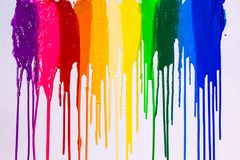 Rainbow cilors of screen print colors are dripping. In white background royalty free stock photos