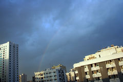 Rainbow in the city. Rainbow viewed in the middle of the city stock image