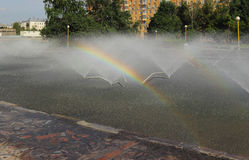 Rainbow in a city fountain Royalty Free Stock Image