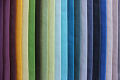 Coloured pieces of cloth, aligned in a rainbow pattern Stock Images