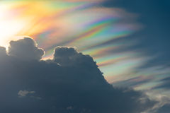 Rainbow cloud  with spectrum light. Rare phenomenon  in summer Stock Photography