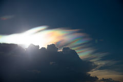 Rainbow cloud with spectrum light , rare phenomenon in summer. Rainbow cloud with spectrum light and sunset , rare phenomenon in summer Stock Photography