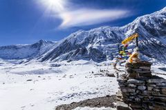 Rainbow cloud and stone stupa with prayer flags near Tilicho lake. Nepal, Himalaya mountains, Annapurna Conservation Area. Rainbow cloud and stone stupa with royalty free stock image
