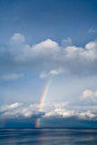 Rainbow through clouds Royalty Free Stock Images