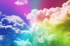 Rainbow and clouds. Rainbow colors over the sky covered with clouds royalty free stock image