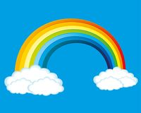 Rainbow and clouds. Rainbow and clouds on a blue background Stock Photo