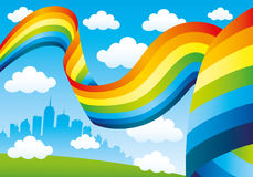 Rainbow and clouds in the blue sky Stock Photo