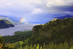 Rainbow and clouds on the Columbia Gorge Oregon. Royalty Free Stock Images