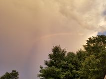 Rainbow through the clouds Royalty Free Stock Photography