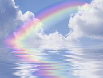Rainbow and Clouds Reflection stock photography