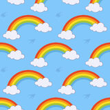 Rainbow and Clouds Seamless Pattern. A cartoon spring seamless pattern with rainbow, clouds and swallows,  on blue background. Eps file available Stock Photos