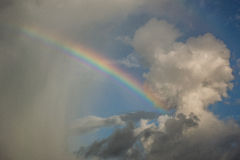 Rainbow on cloudy day Stock Photography