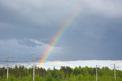 Rainbow on the cloudy sky Royalty Free Stock Photos