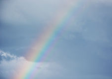 Rainbow on the cloudy sky Royalty Free Stock Photo