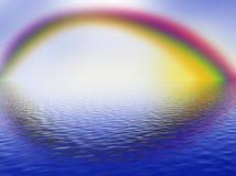 Rainbow, cloudy sky and ocean Royalty Free Stock Photos