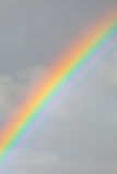 Rainbow in the cloudy sky Stock Photo