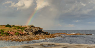 Rainbow Clovelly beach Royalty Free Stock Image