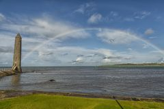 Rainbow on the coast at Larne. Rainbow at the coast in larne north ireland Stock Images