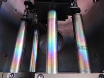 Rainbow on coated steel rods inside vacuum deposition chamber royalty free stock photo