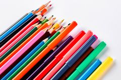 Rainbow collection of pencils for drawing. Big collection of pensils and markers of different colors, white background Stock Images