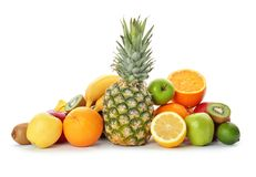 Rainbow collection of ripe fruits. On white background stock image
