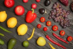 Rainbow collection of ripe fruits and vegetables. On wooden background, top view Stock Images