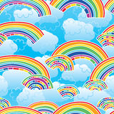 Rainbow coloful sky blue seamless pattern. This illustration is design and drawing stylish rainbow with cloud in blue color background bright in seamless pattern Royalty Free Stock Photos