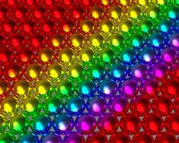 Rainbow color balls reflective background. Metallic rainbow color beads reflective textures. Colorful spheres array Royalty Free Stock Images