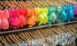 Rainbow color bikini and colorful. Colorful bikini at the beach scene Stock Image