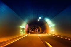 Rainbow color blurry abstract tunnel driving Stock Photos