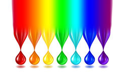 Rainbow color drops on white. The rainbow turns into not transparent drops of paint of iridescent color. Separately on a white background. Realistic Stock Photo