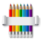 Rainbow color pencils and curled paper sheet with Royalty Free Stock Photos