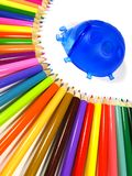 Rainbow of color pencils and stand ladybird. Rainbow consist of color pencils and stand for pencils on the white background Stock Photo