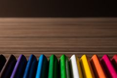 Rainbow color pencils on the wood background. Colorful paint Stock Photo