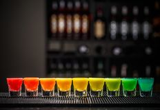 Rainbow color shots. On the bar counter Royalty Free Stock Photo