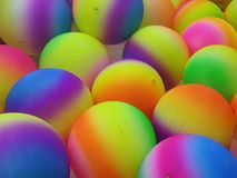 Rainbow colored balls Stock Images
