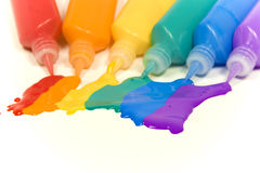 Rainbow from colored blot. Glass deco paints with tubes royalty free stock images