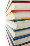 Rainbow colored books. Rainbow colored old books closeup Stock Image