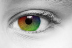 Rainbow Colored Childs Eye. Macro of childs eye with rainbow colors Royalty Free Stock Image