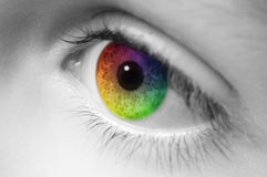 Rainbow Colored Childs Eye. Macro of childs eye with rainbow colors Royalty Free Stock Photo