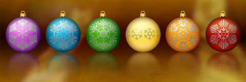 Rainbow colored Christmas ornaments Stock Images